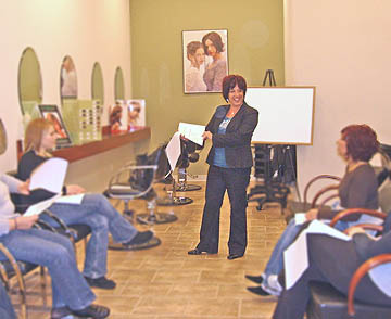 Robyn teaching hair professionals about her non-toxic color processes